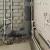 Каким способом закрыть трубы в ванной?
